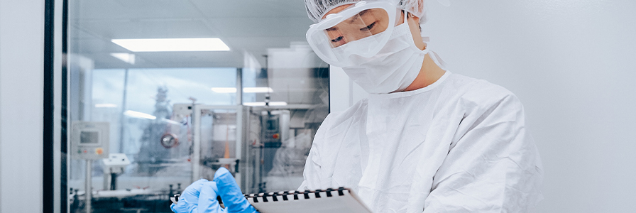 Worker in manufacturing cleanroom