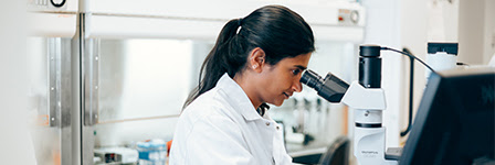 Scientist at microscope