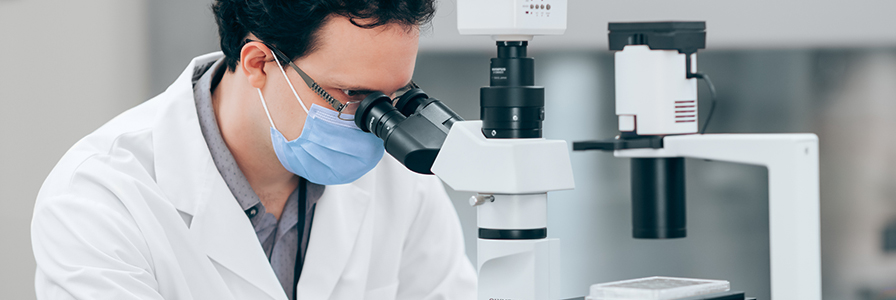Scientist at microscope