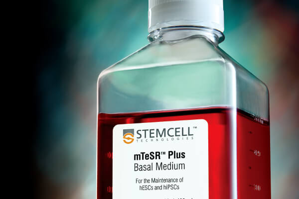 A bottle of mTeSR™ Plus human pluripotent stem cell (hPSC) maintenance media, manufactured under relevant current good manufacturing practices (cGMPs).
